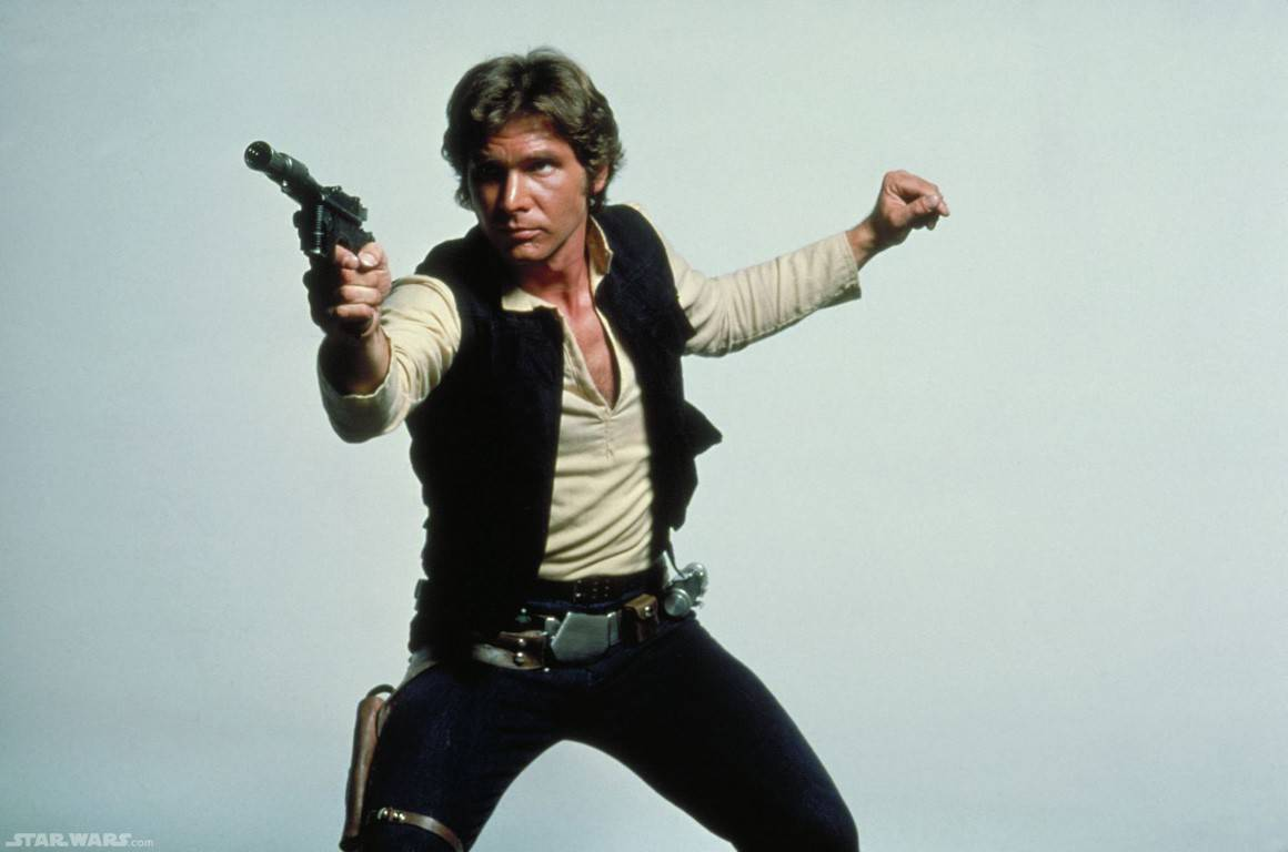 Harrison Ford as Han Solo, posing with DL-44 blaster